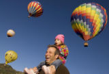 Paul Conrad The Aspen Times Elle Eggleston, 2, and her dad Bubba watch as hot air balloons take...