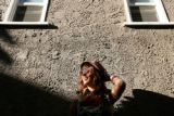 Alicia Forrest, 24, smiles in the sunlight outside of a relatives home in Long Beach, California.