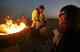 Alicia Forrest, 24, right, attends a Bonfires for Peace gathering hosted by Traveling Bonfires in...