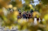 Runners head down Shady Croft Drive during the Liberty Bell Invitational Cross-Country Meet,...