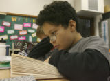 Fabian Silva reads a book during in his 4th & 5th grade class, Monday morning, September 15,...