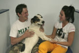 Clay Carson (cq) and Chelsi Parrado (cq), let to right, check out a English Fox Hound mix for...