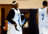 Denver, Colo., photo taken October 5, 2004- Nuggets forward Carmelo Anthony (left) and center...