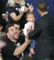 Jack Martinez from Denver  reacts as U.S. Senator Barack Obama picks up his daughter Dayliha 14...