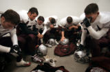 (DENVER, Co., SHOT 9/30/2004) Silver Creek High School football players gather together to pray in...