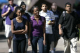 Edom Haile left, and Tina Kidane (purple) , both Juniors at Metro, walk between classes at Metro...