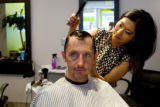 Stylist Kate Shapland cuts Todd Schaefer's hair at Metroboom, when Eat! Drink! Shop! visits a...