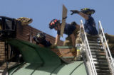 (Boulder, Colo., SEPTEMBER 19, 2004)  Boulder firefighters finish working an early morning fire on...