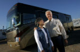 DM0242  Ken and Judy White pose for a portrait with their recreational vehicle near their home in...