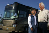DM0251  Ken and Judy White pose for a portrait with their recreational vehicle near their home in...