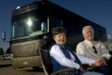 DM0270  Ken and Judy White pose for a portrait with their recreational vehicle near their home in...