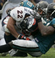 (JACKSONVILLE, FLA., SEPTEMBER 19, 2004) - Denver Broncos' #22, Quentin Griffin is wrapped up by...