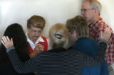Nancy Seagrove  left, prays with her fellow members of the Behind the Scenes Prayer Group Sunday...