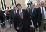 Former CEO of Qwest, Joseph Nacchio, arrives at Federal Court with an entourage for the start of...
