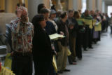 People wait in long lines to vote on election day. Computer delays and a large turnout caused...