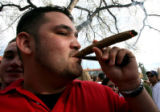 James Smith (cq),22, burns a large blunt as thousands of people showed up to smoke pot on Norlin...