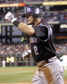 Colorado Rockies' Troy Tulowitzki  reacts after scoring from second base on a RBI single by...