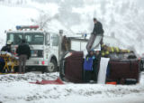 Emergency responders work to free a man from his rolled-over vehicle on the median of I-70 near...
