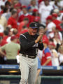 Colorado Rockies manager Clint Hurdle steps out of the dugout to congratulate his team after they...
