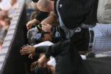 Yorvit Torrealba is congratulated by teammates in the Colorado Rockies dugout after his second...