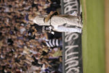Colorado Rockies pinch hitter Seth Smith celebrates at third base after his triple in the sixth...