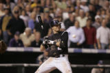 The Colorado Rockies' Troy Tulowitzki dodges a pitch during an at-bat in the 12th inning. The...