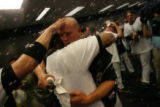 Matt Holliday celebrates in the Colorado Rockies clubhouse after their 9-8 victory in 13 innings....