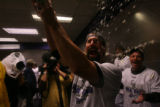 Todd Helton celebrates in the Colorado Rockies clubhouse after the team's 9-8 victory in 13...