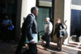 Herbert Stern, lead attorney for Joe Nacchio, walks alone behind the pack of media surrounding his...