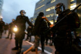 Police detain protesters at 15th and Court Streets on Monday, August 25, 2008. Police blocked in a...