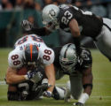 (OAKLAND, CA., OCTOBER 17, 2004)  Denver Broncos' #88, Jeb Putzier is tackled by Oakland Raiders'...