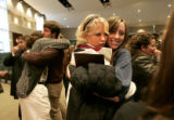 1007 Hugs abound, as friends and Youth With a Mission students Hanna Blackford, CQ, left, and...