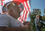 (102)  Jim Haas, left, of Grand Junction, listens in along with other volunteers and supporters of...