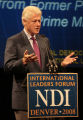 Former President Bill Clinton speaks to panelists at the International Leaders Forum, Tuesday...