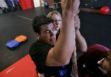 Nikko Landeros strains to pull himself up, hand-over-hand, working with Berthoud physical...