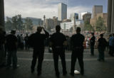 "Denver Police officers watch as hundreds gather to recognize ""National Pot Smokers Day""..."