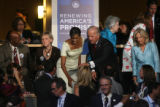 Michelle Obama and Democratic vice presidential nominee Senator Joe Biden listen to Hillary...