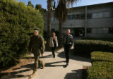 Lance Cpl. Lance Hering walks out of a court building after his court martial at Camp Pendleton in...