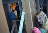 Kristen Pallasch, 9, tries to get a nail out of a beam in the upstairs of Maggie and Jim...