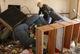 David Gully goes through belongings in his son's home on the outskirts of Greeley a day after a...