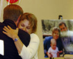 (DENVER, COLO.  May 27, 2004 )  Samantha Sherwood  hugs Thomas C. Puckett (CEO of Bonfils Blood...