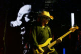 R.E.M. bassist Mike Mills performs at Red Rocks Amphitheatre. Modest Mouse and The National are...