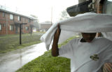 "(DENVER, Colo., Aug. 6, 2004)  Lawrence ""Lolo"" (last name?), 12, tries to keep dry while..."