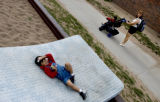 (DENVER, Colo., Aug. 23, 2004)  Samuel Jasso, 3, plays on a mattress lying in a playground in...