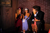 Bridget Black, Nikki Friedin and Tim Shannon sit in the corner of the Speakeasy portion of the...