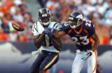 (DENVER, Co., SHOT 9/26/2004) The Denver Broncos' Willie Middlebrooks (#23, CB) breaks upa pass...