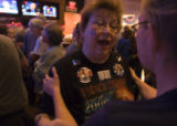 (267) Dottie Rawsky, 62, of Broomfield, shows off her Obama tattoos while talking with a friend at...