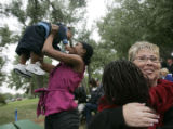 Edwina Mahoney throws her son Aidan Mahoney, left, while Ruth Robbins, right, hugs Nadia Mahoney,...