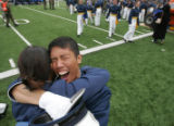 Mario Mendoza hugs a fellow graduate at the Air Force Academy graduation where about 950 cadets...