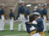 Two cadets hug after receiving their diplomas at the Air Force Academy graduation where about 950...